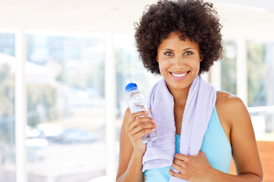 Woman Holding a Water Bottle After a Workout - Isolated